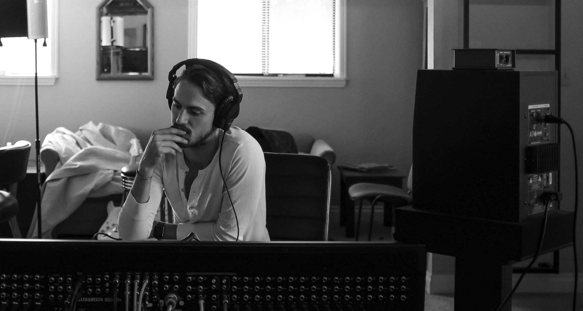 A man wearing headphones is enjoying music